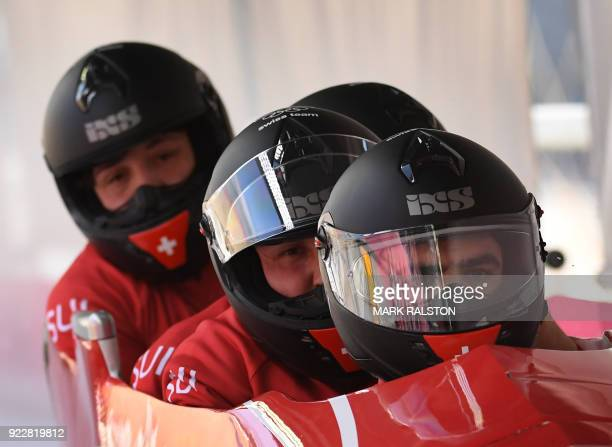 Pilot Clemens Bracher of Switzerland leads his team as they cross the finish line in the 4man bobsleigh training during the Pyeongchang 2018 Winter...