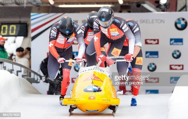 Pilot Clemens Bracher with Alain Knuser Marcel Dobler and Michael Kuonen of Switzerland compete during the first run of the fourman Bobsleigh event...