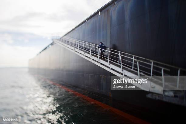 pilot climbing stairs on oil tanker. - industrial ship stock pictures, royalty-free photos & images