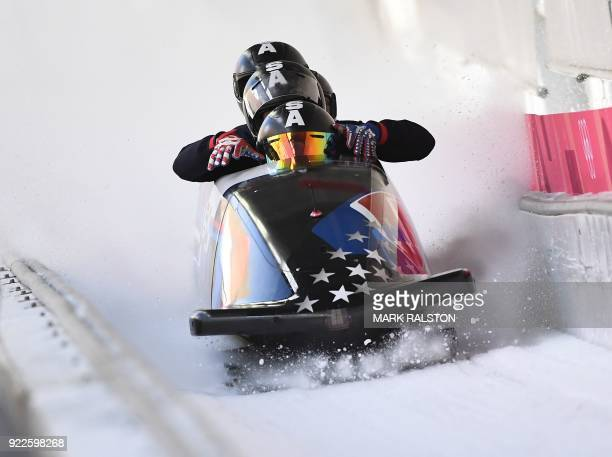 TOPSHOT Pilot Codie Bascue of the US leads his team as they cross the finish line in the 4man bobsleigh training during the Pyeongchang 2018 Winter...
