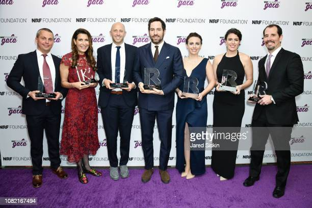 Pilot Corporation Tina Sharkey Randy Goldberg Dave Heath Cameron Cruse Lisa Bradley and Mike Brady win the 2019 Givers award at the 2019 NRF...