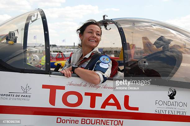 Pilot Dorine Bourneton celebrates after taking part in the first worldwide aerobatic show performed by a paraplegic woman at the Paris Air Show 2015...
