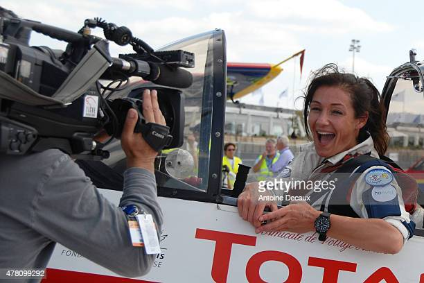 Pilot Dorine Bourneton celebrates, after taking part in the first worldwide aerobatic show performed by a paraplegic woman, at the Paris Air Show...