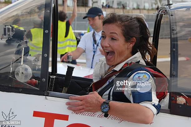 Pilot Dorine Bourneton celebrates after taking part in the first worldwide aerobatic show performed by a paraplegic woman, at the Paris Air Show 2015...