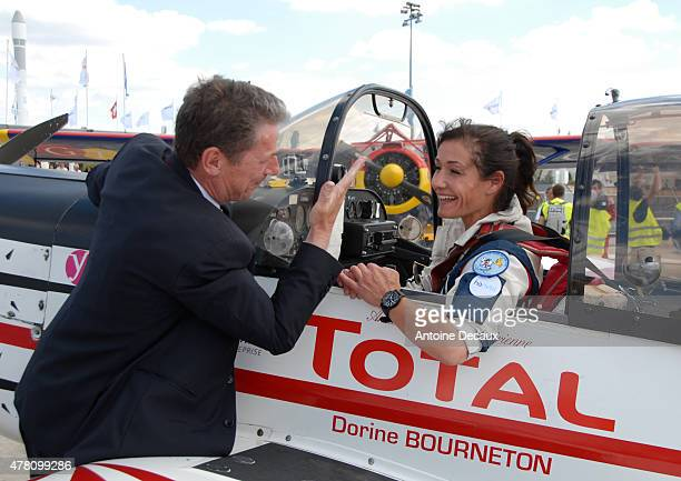 Pilot Dorine Bourneton celebrates with Gilles Furnier General Manager of the Paris Air Show after taking part in the first worldwide aerobatic show...