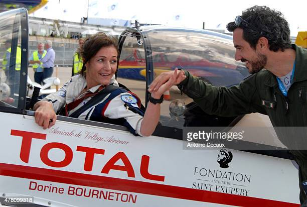 Pilot Dorine Bourneton celebrates with her physical and mental trainer, Samuel Degoute, after taking part in the first worldwide aerobatic show...