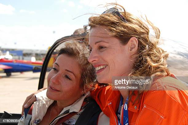 Pilot Dorine Bourneton celebrates with Jane Planchon first woman piloting a Canadair firefighter aircraft after she took part in the first worldwide...