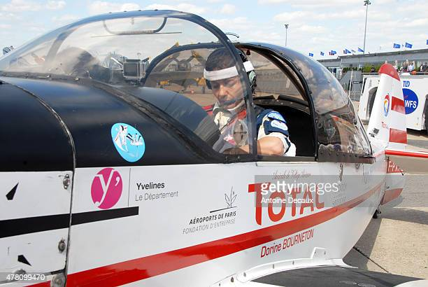 Pilot Dorine Bourneton concentrates before taking part in the first worldwide aerobatic show performed by a paraplegic woman, at the Paris Air Show...