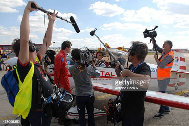 Pilot Dorine Bourneton is interviewed after taking part in the first worldwide aerobatic show performed by a paraplegic woman, at the Paris Air Show...