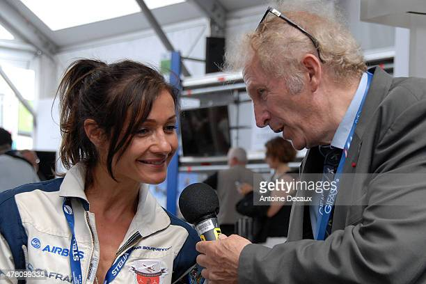 Pilot Dorine Bourneton is interviewed by the former pilot Gerard Feldzer before taking part in the first worldwide aerobatic show performed by a...