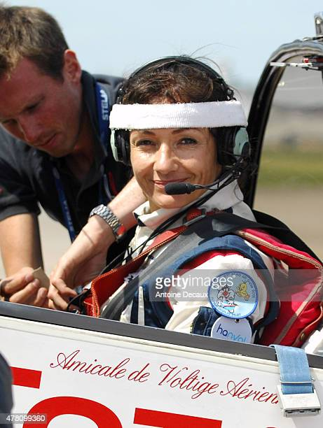 Pilot Dorine Bourneton is secured to her seat before taking part in the first worldwide aerobatic show performed by a paraplegic woman, at the Paris...
