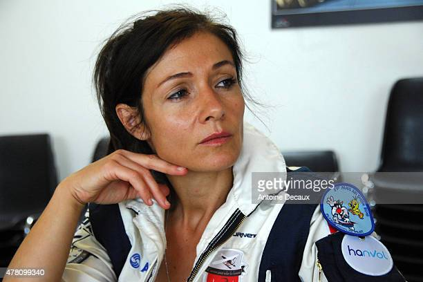 Pilot Dorine Bourneton listens to the last instructions from her flight instructor before taking part in the first worldwide aerobatic show performed...