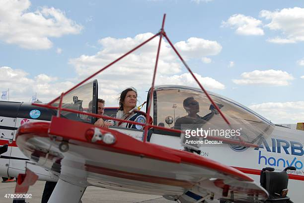 Pilot Dorine Bourneton looks up at the sky before taking part in the first worldwide aerobatic show performed by a paraplegic woman, at the Paris Air...