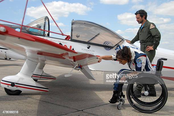 Pilot Dorine Bourneton performs the preflight inspection of her CAP 10 aircraft with her physical and mental trainer, Samuel Degoute, before taking...