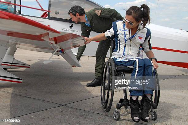 Pilot Dorine Bourneton performs the preflight inspection of her CAP 10 aircraft with her physical and mental trainer Samuel Degoute before taking...