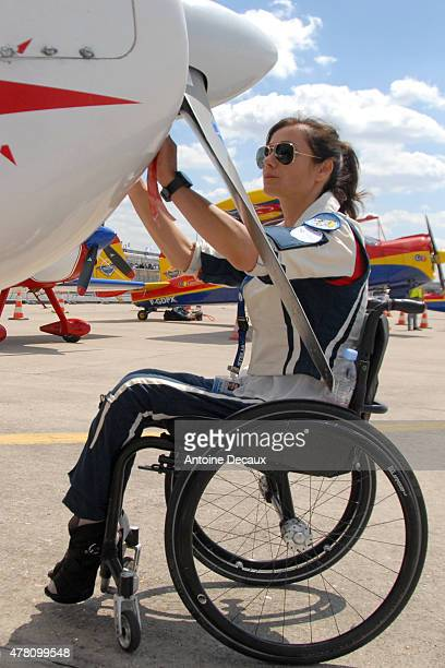 Pilot Dorine Bourneton performs the preflight inspection of her CAP 10 aircraft before taking part in the first worldwide aerobatic show performed by...