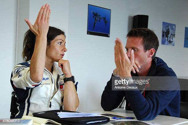 Pilot Dorine Bourneton plans her flight with her instructor Romain Vienne, the 2013 world champion aerobatic glider, before taking part in the first...