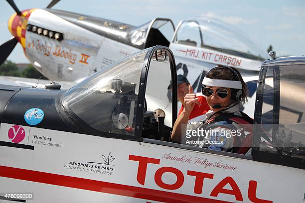 Pilot Dorine Bourneton poses before taking part in the first worldwide aerobatic show performed by a paraplegic woman at the Paris Air Show 2015 in...