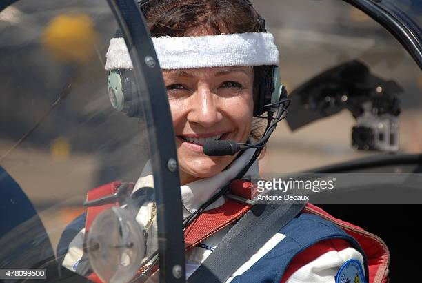 Pilot Dorine Bourneton poses before taking part in the first worldwide aerobatic show performed by a paraplegic woman, at the Paris Air Show 2015 in...