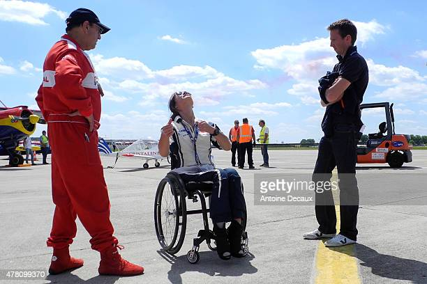 Pilot Dorine Bourneton rehearses her flight with Regis Alajouanine and Romain Vienne, before taking part in the first worldwide aerobatic show...