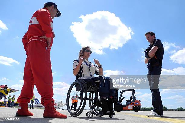Pilot Dorine Bourneton rehearses her flight with Regis Alajouanine and Romain Vienne before taking part in the first worldwide aerobatic show...
