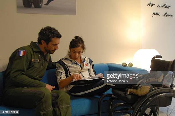 Pilot Dorine Bourneton relaxes with her physical and mental trainer Samuel Degoute before taking part in the first worldwide aerobatic show performed...