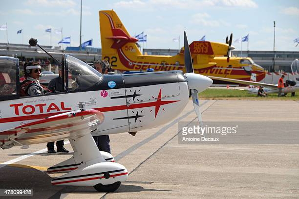 Pilot Dorine Bourneton waits for the clearance from the air traffic control on the parking before taking part in the first worldwide aerobatic show...