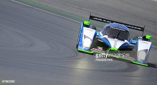 A pilot drives a PeugeotPescarolo during the qualifying round of the 24 Heures du Mans endurance race on May 25 on the MagnyCours racetrack central...