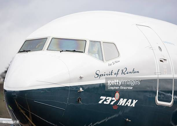 Pilot Ed Wilson waves from the cockpit of a Boeing 737 MAX 8 airliner after landing it at Boeing Field to complete the plane's first flight on...