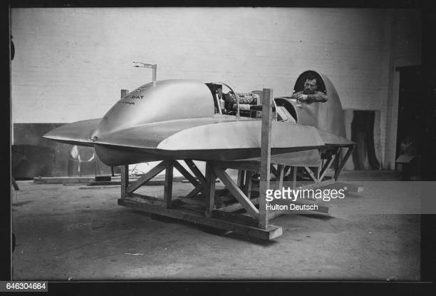 Pilot Edward Spurr sits in the speedboat Empire Day which was built by him designed by him and T E Lawrence and which he will be using in an attempt...