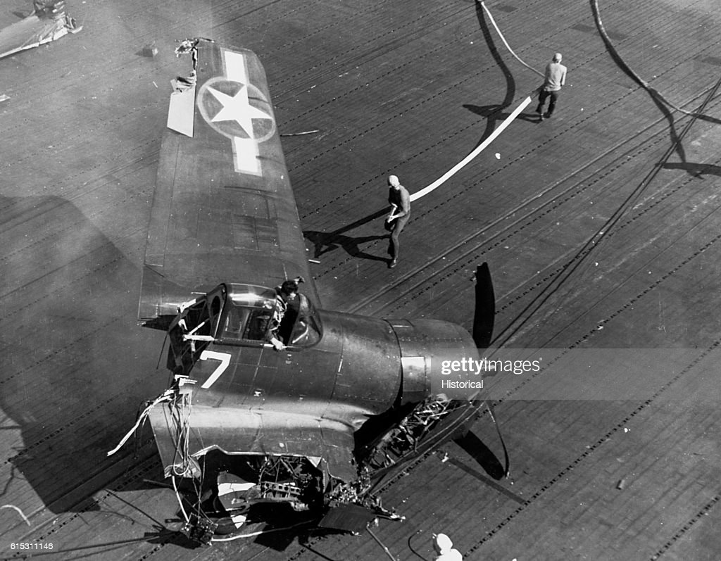 Fighter Crashes Onto Carrier : News Photo