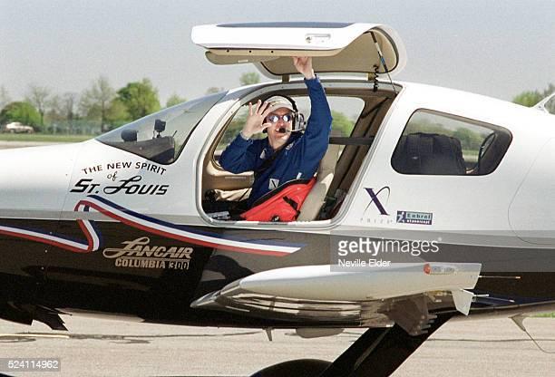 "Pilot Erik Lindbergh waves from the cockpit of ""the New Spirit of St. Louis"" single engine aeroplane, before taking off. Erik, grandson of Charles..."