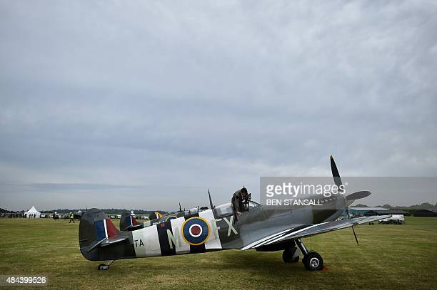 Pilot exits the cockpit of a Spitfire aircraft at Biggin Hill airfield in Kent, on August 18, 2015. World War II aircraft including 18 Spitfires and...