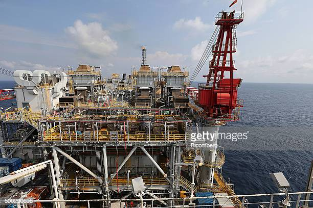 A pilot flame burns beyond pipework aboard the Agbami floating oil production storage and offloading vessel operated by Chevron Corp in the Agbami...