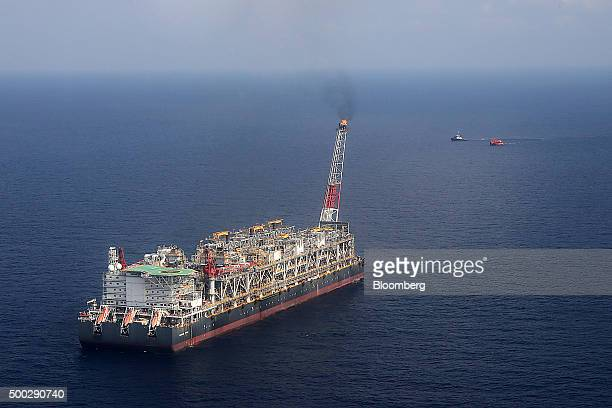 A pilot flame burns on the Agbami floating oil production storage and offloading vessel operated by Chevron Corp in the Agbami deepwater oilfield in...