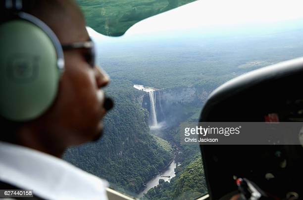 A pilot flies over the iconic Kaieteur Falls in the Guyana Hinterland on day 13 of an official visit to the Caribbean on December 3 2016 in Surama...