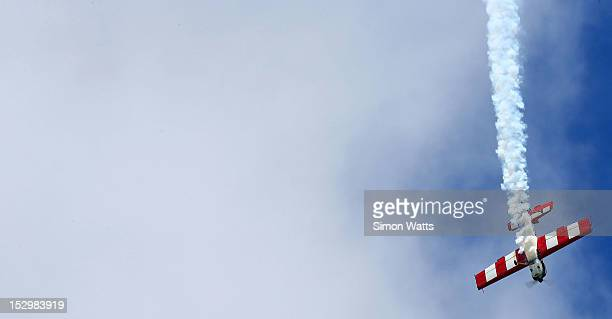 A pilot flies performs aerobatics during an airshow commemorating the completion of the rebuild of de Havilland Mosquito KA 114 on September 29 2012...
