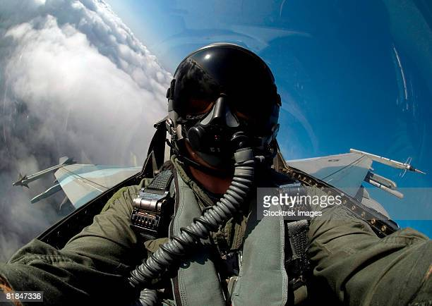 A pilot flying a F-16 Fighting Falcon.