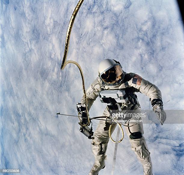 Pilot for the GeminiTitan 4 Astronaut Edward H White II conducts a spacewalk on June 3 1965 during the third revolution of the GT4 spacecraft around...