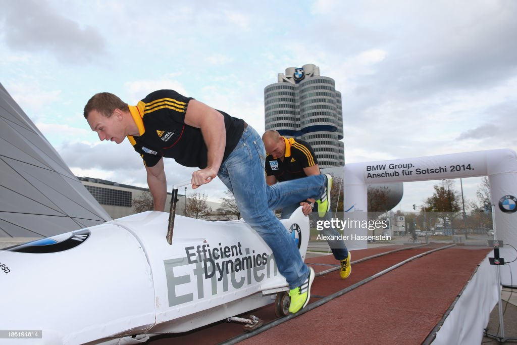 Pilot Francesco Friedrich and Alexander Mann of Team Germany 1 push practice after the season opening press conference of the German Bobsleigh and Skeleton federation at BMW Welt on October 29, 2013 in Munich, Germany.