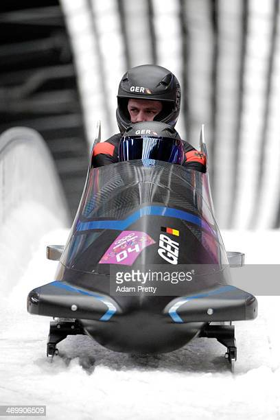 Pilot Francesco Friedrich and Jannis Baecker of Germany team 1 finish a run during the Men's TwoMan Bobsleigh on Day 10 of the Sochi 2014 Winter...