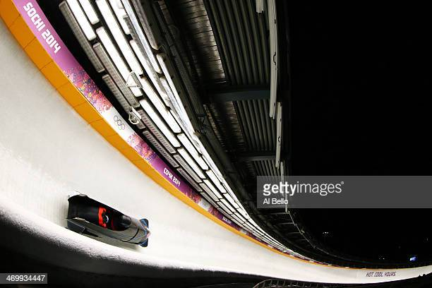 pilot Francesco Friedrich and Jannis Baecker of Germany team 1 make a run during the Men's TwoMan Bobsleigh on Day 10 of the Sochi 2014 Winter...