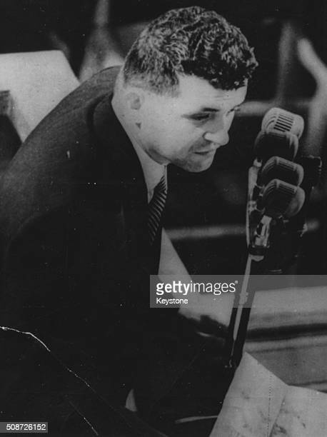 Pilot Francis Gary Powers who was shot down over Russia and faced spying charges speaking in to a microphone following his return to the US August...