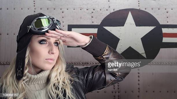 pilot girl with retro equipment next to us aircraft - aviation hat stock photos and pictures