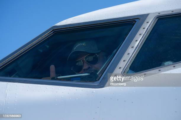 Pilot gives a thumbs-up from the cockpit of a Boeing Co. 737-800 jetliner operated by Avelo Airlines at Charles M. SchulzSonoma County Airport in...