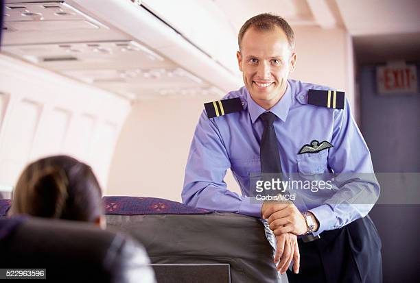 pilot greeting passengers - epaulettes stock pictures, royalty-free photos & images