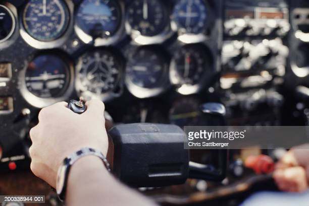 Pilot handling controls, close-up (focus on hand)
