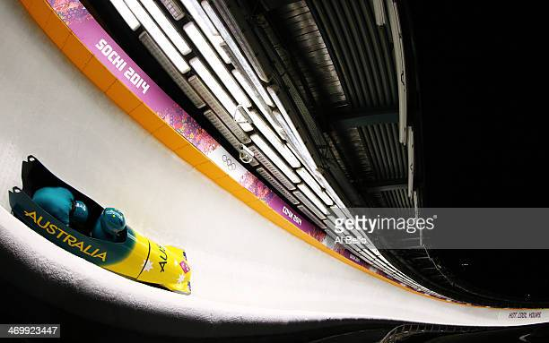 Pilot Heath Spence and Duncan Harvey of Australia team 1 make a run during the Men's TwoMan Bobsleigh on Day 10 of the Sochi 2014 Winter Olympics at...