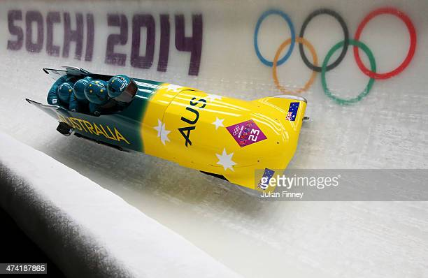 Pilot Heath Spence Gareth Nichols Duncan Harvey and Lucas Mata of Australia team 1 make a run during the Men's Four Man Bobsleigh heats on Day 15 of...