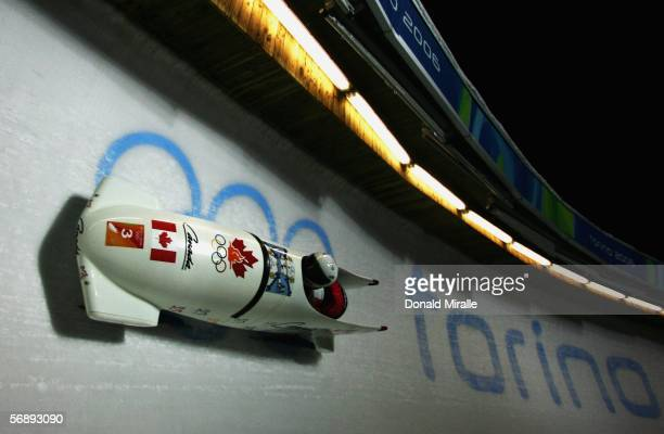 Pilot Helen Upperton and Heather Moyse of Canada 1 compete in the Two Woman Bobsleigh event on Day 10 of the 2006 Turin Winter Olympic Games on...